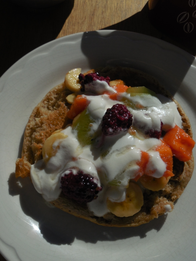 Whole wheat pancakes topped with fresh fruits (banana, papaya, kiwi, blackberries), soured cream and honey. photo © Lorraine Caputo